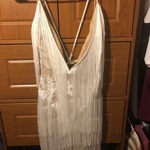 Dresses - Get NYE ready....Sexy fringe dress **never worn**